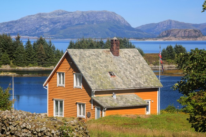 little yellow house on an island in norway