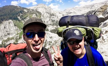 Two happy backpacker men having fun in the mountains of Sequoia National Park