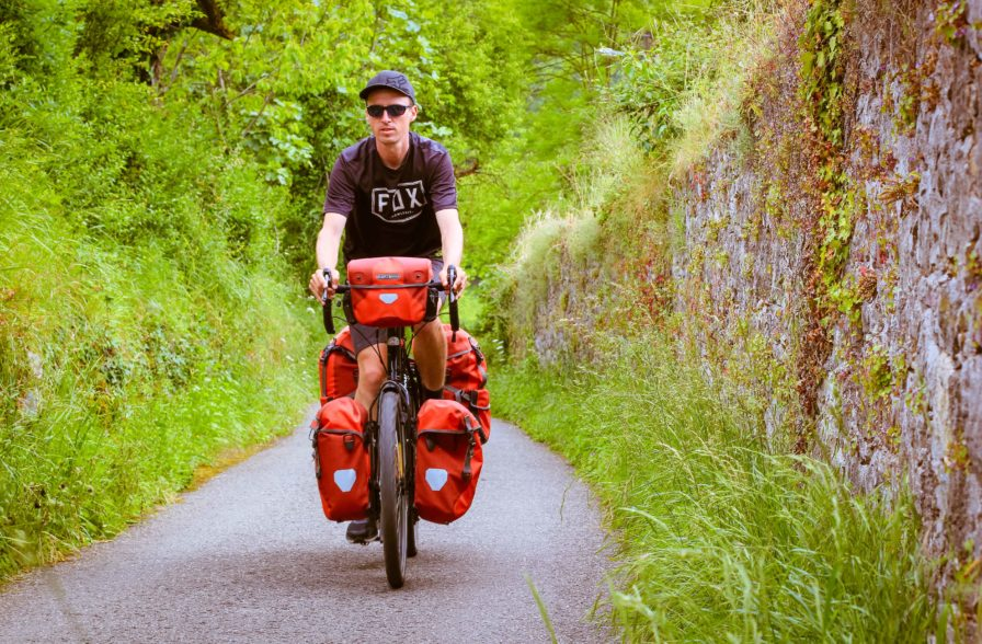 darren alff on a fully-loaded touring bicycle in oviedo spain