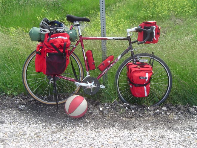 red lone peak panniers and handlebar bag