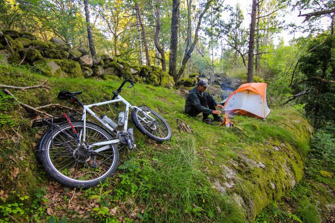 Sweden bike tour with tent and campfire