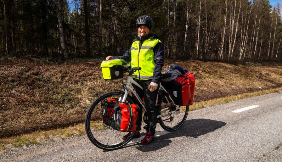 blonde woman solo bike tour in Norway