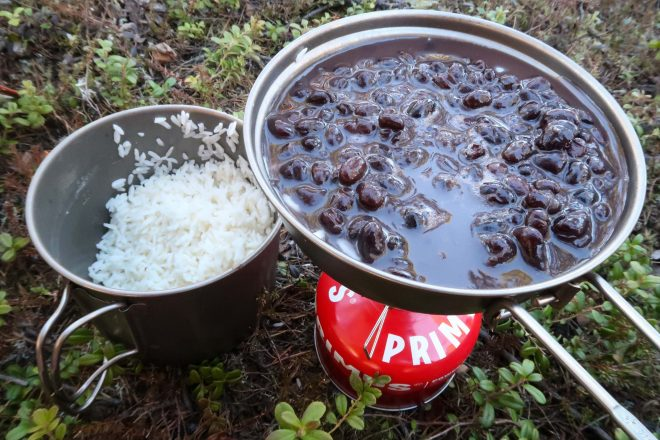 Cookign beans and rice on camp stove