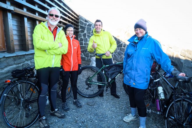 Mark Hyett, Jacquie Hyett, Terri Jockerst and bicycle tourists in Nordkapp Norway