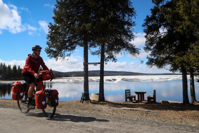 Bicycle touring past a frozen lake