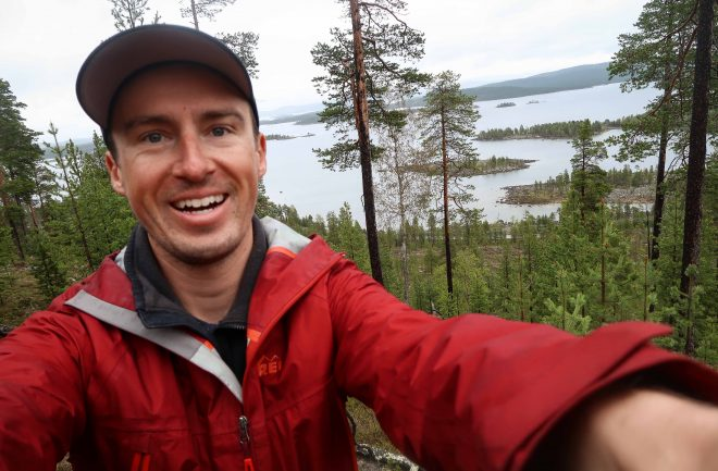 Darren Alff smiling lake selfie in Finland