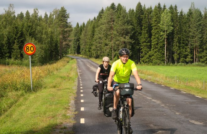Doug Ireland and Line Gammelli riding bikes in northern Sweden