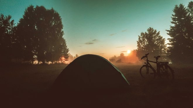 tent and bicycle looking into Swedish sunset