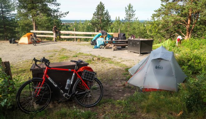 campsite with tents and fire pit in Lulea, Sweden