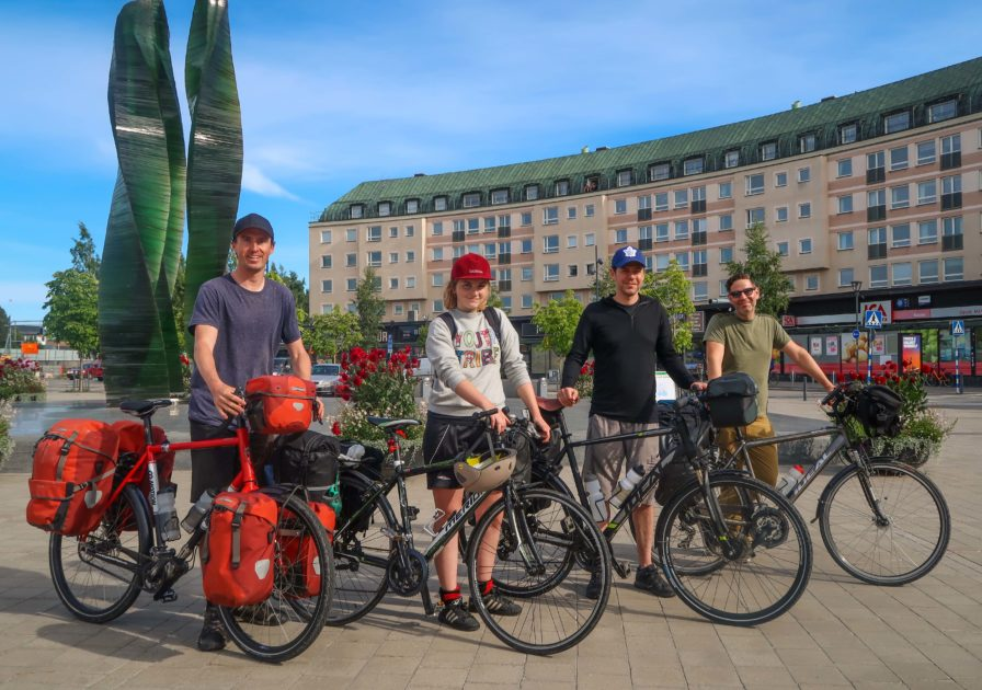 Darren Alff, Line Gammelli, Doug Ireland and Roberto LoRusso with their loaded touring bicycles in the center of Umea, Sweden