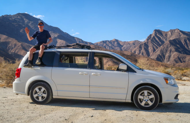 Sitting on the roof of my white Minivan Campervan