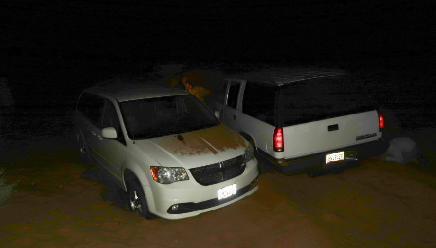 two vehicles stuck in deep sand