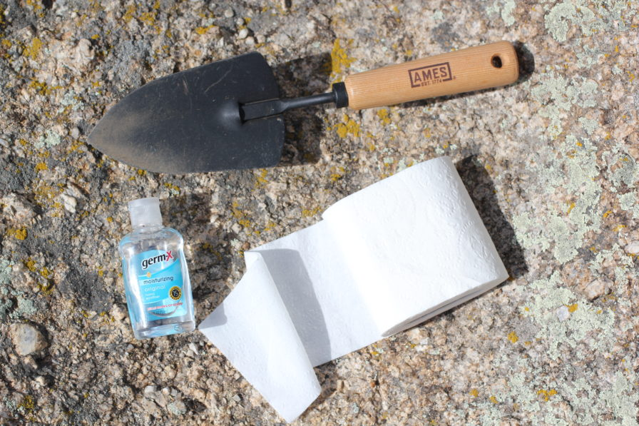 spade, toilet paper and hand sanitizer