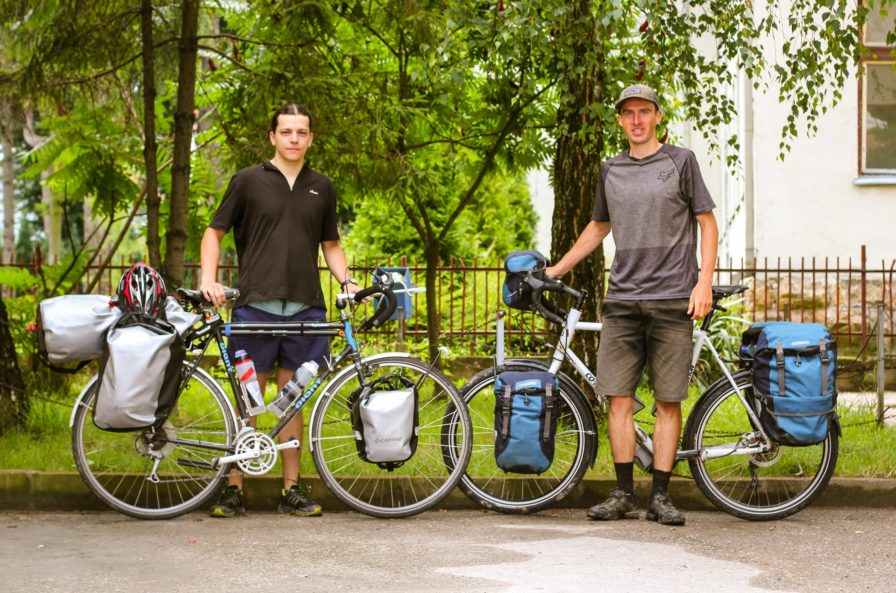 Two young men with touring bicycles