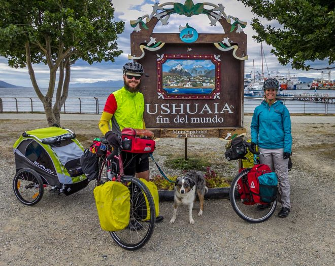 Young couple cycle touring with a dog