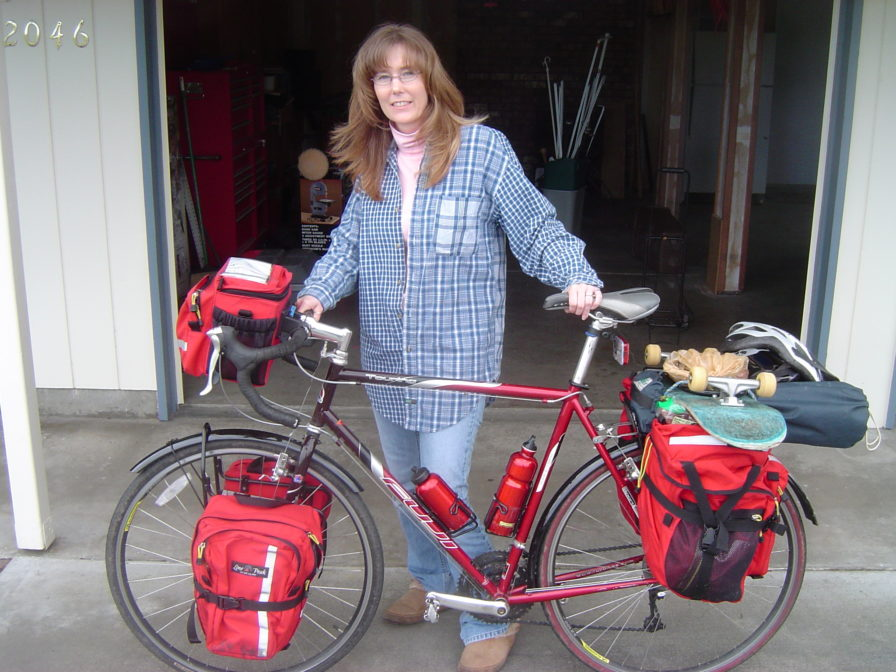 woman with 2003 fuji touring bicycle and lone peak panniers