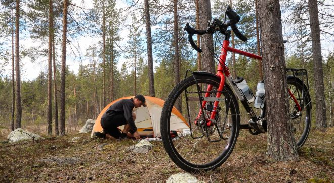 Bicycle touring and wild camping outside JokkMokk, Sweden forest