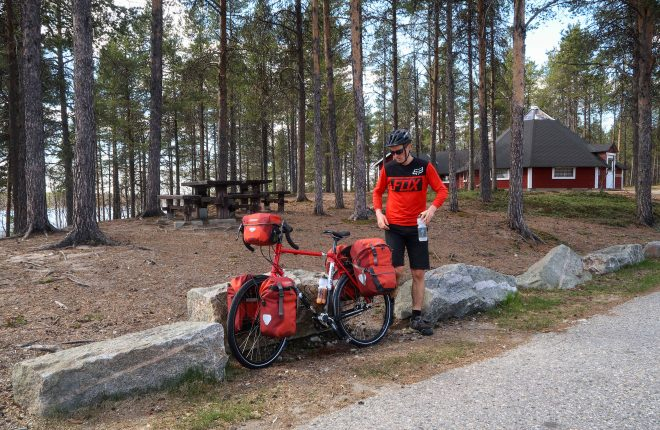 Bicycle tourist at rest stop in Finland