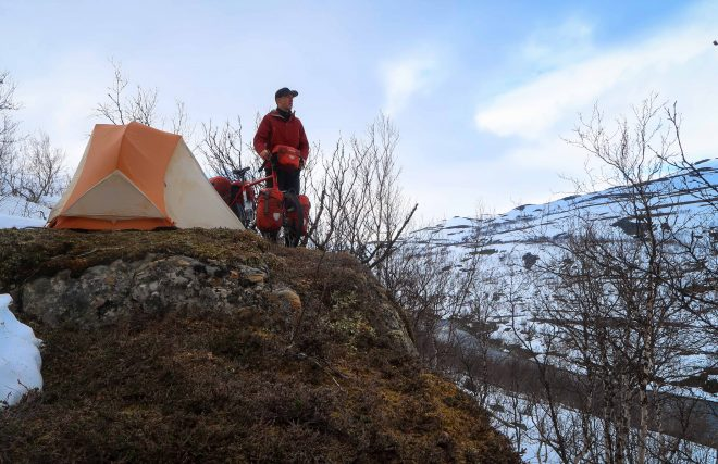 Bicycle Touring Pro cliff's edge campsite in snow-covered Norway