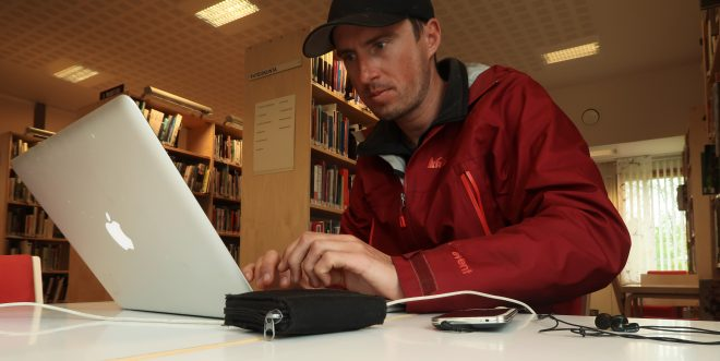 Man working on his computer inside public library in Finland