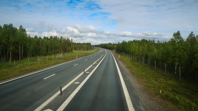 View of highway in Sweden from inside bus