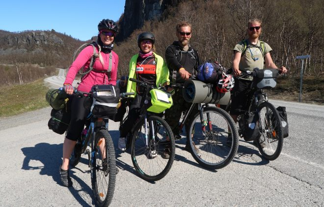 Four bicycle tourists - men and women in norway