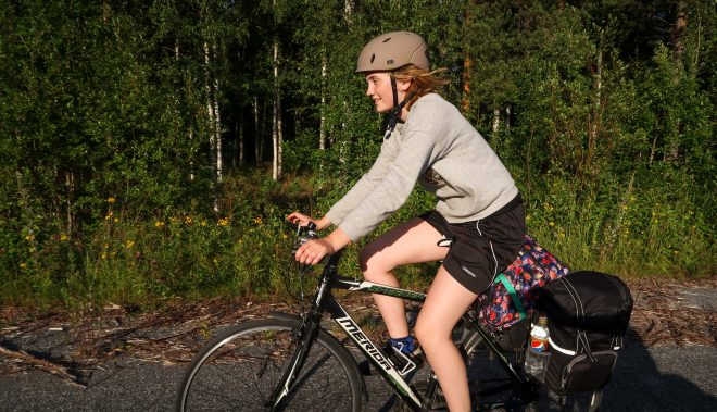 Line Gammelli rides her touring bicycle in northern Sweden