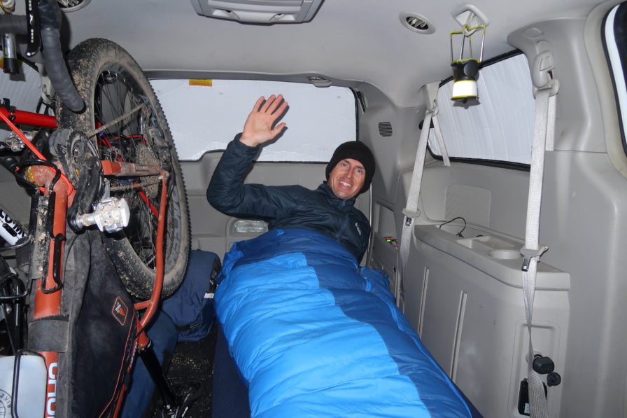 Vanlif traveler Darren Alff sleeping in his Dodge Caravan campervan