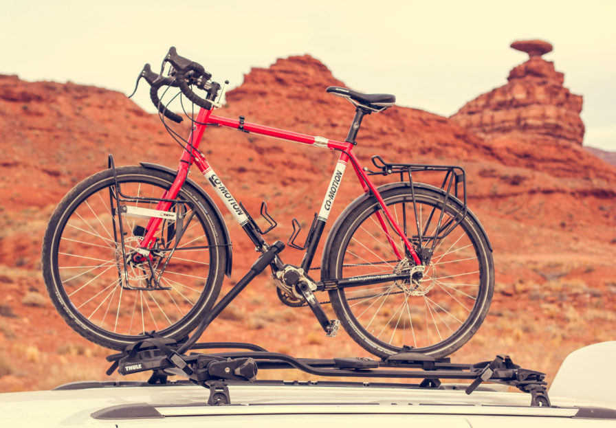Touring Bicycle on a Thule Proride Rooftop bike rack with Mexican Hat, Utah in the background