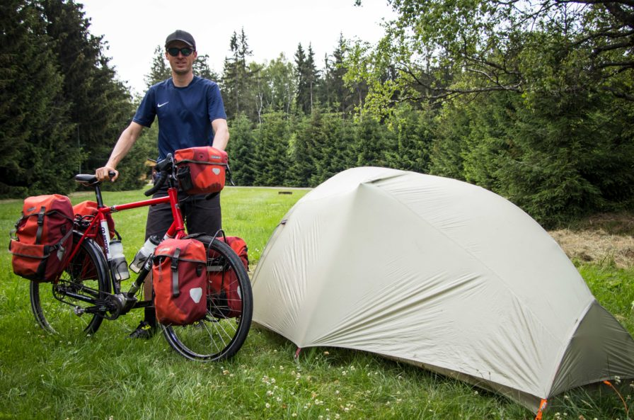 Darren Alff on bike tour with green tent and red touring bicycle