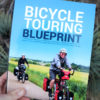 the bicycle touring blueprint holding
