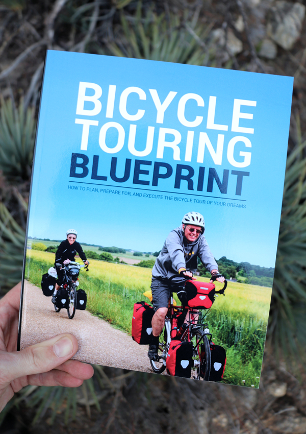 "Holding a copy of ""The Bicycle Touring Blueprint"" in my hand"