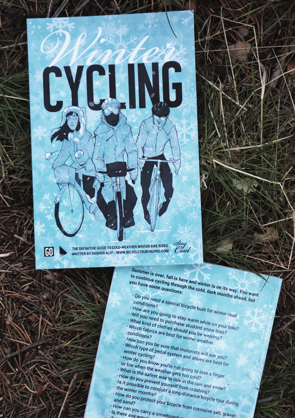 Winter Cycling - front and back book cover laying in grass