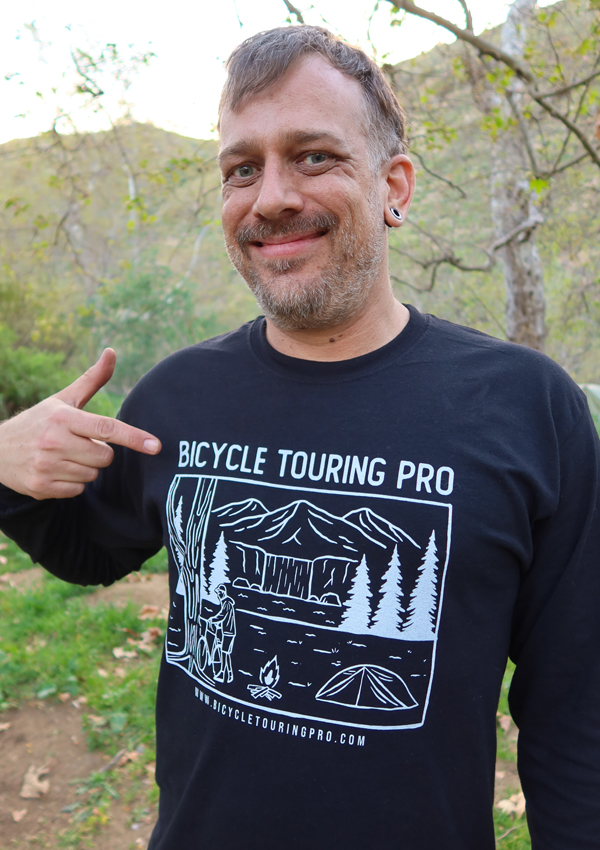 Bicycle Touring Pro: Wild Camping T-Shirt modeled on middle-age man