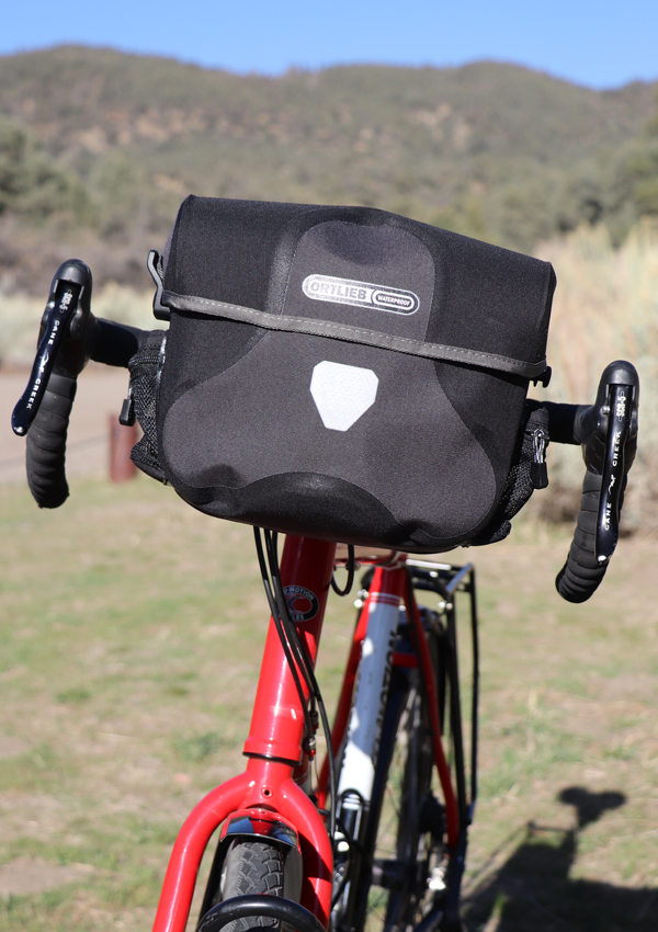 Black/Gray Ortlieb Ultimate 6 Plus 7 Liter Handlebar Bag on touring bicycle with drop bars